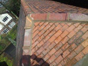 cap ridging over fiberglass flat roof.